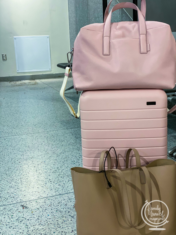 A stack of pink AWAY suitcases