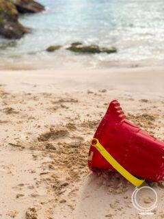 Beach pail in sand