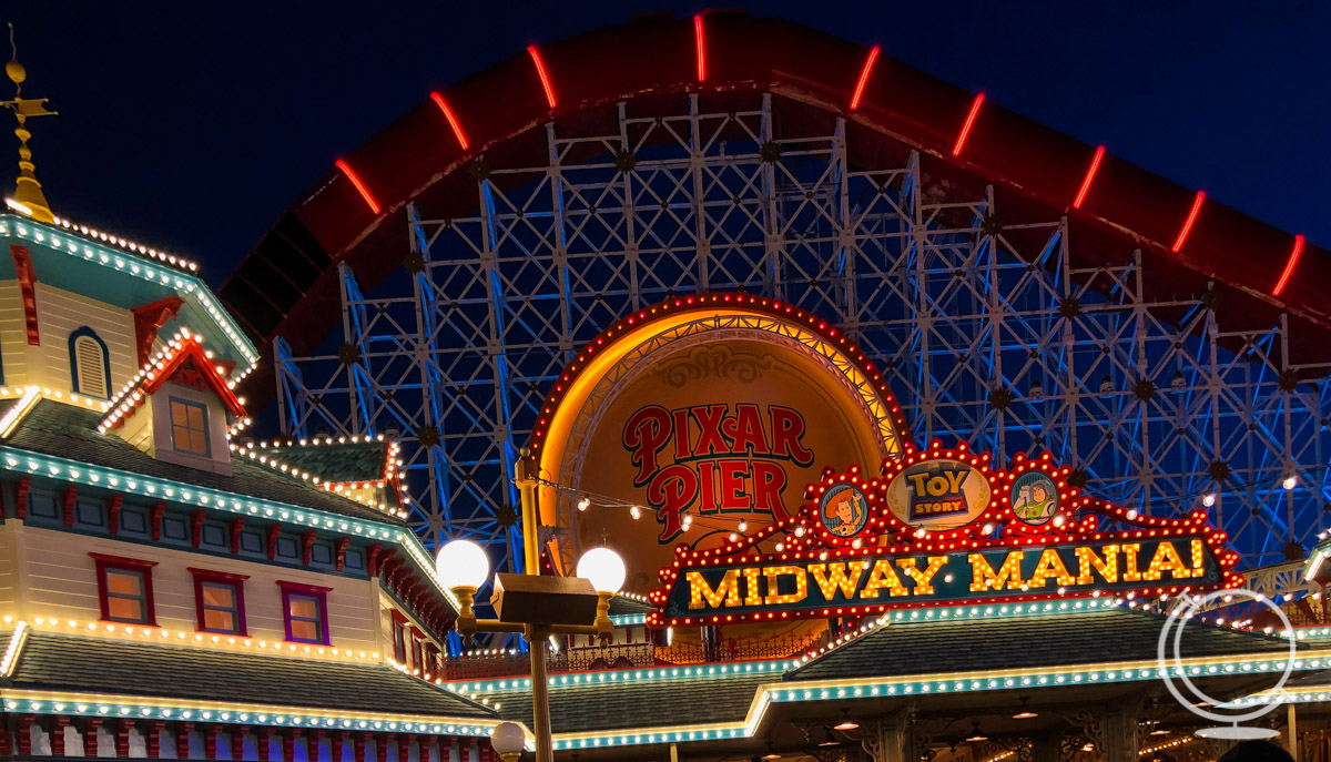 Pixar Pier at night with the Incredicoaster and Toy Story Midway Mania